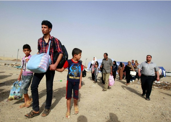 Refugees fleeing from Mosul head to the self-ruled northern Kurdish region in Irbil, Iraq, 350 kilometers (217 miles) north of Baghdad, Thursday, June 12, 2014. The Islamic State of Iraq and the Levant, the al-Qaida breakaway group, on Monday and Tuesday took over much of Mosul in Iraq and then swept into the city of Tikrit further south. An estimated half a million residents fled Mosul, the economically important city. (AP Photo)/BAG123/655327623054/1406122230